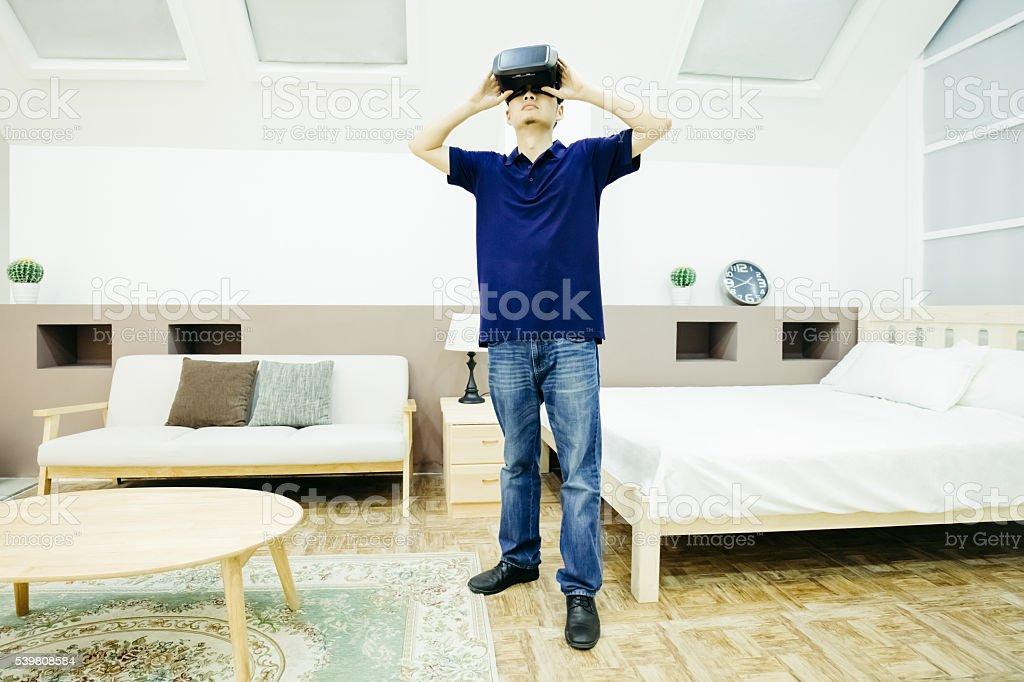 Businessman enjoy VR indoors stock photo