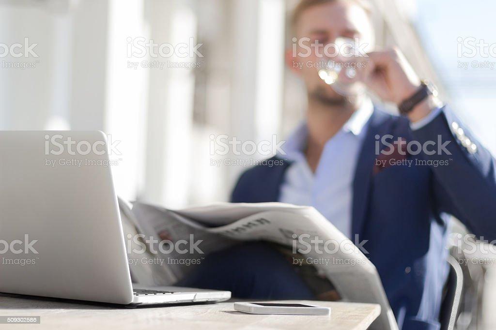 Businessman enjoying white wine stock photo