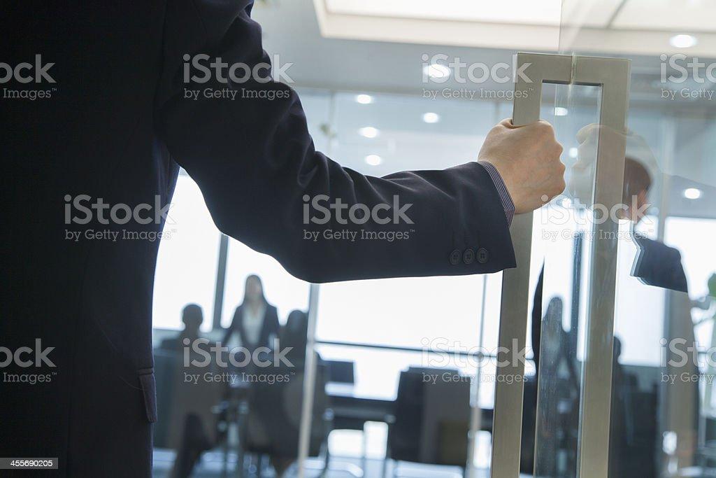 Businessman Entering an Office stock photo