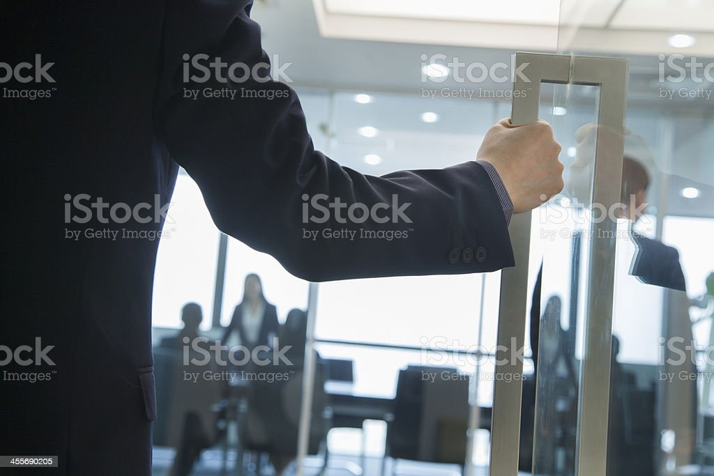 Businessman Entering an Office stock photo