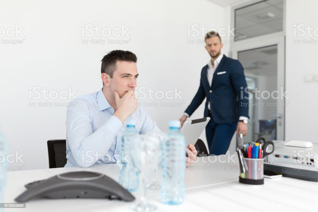 Businessman entering conference room stock photo