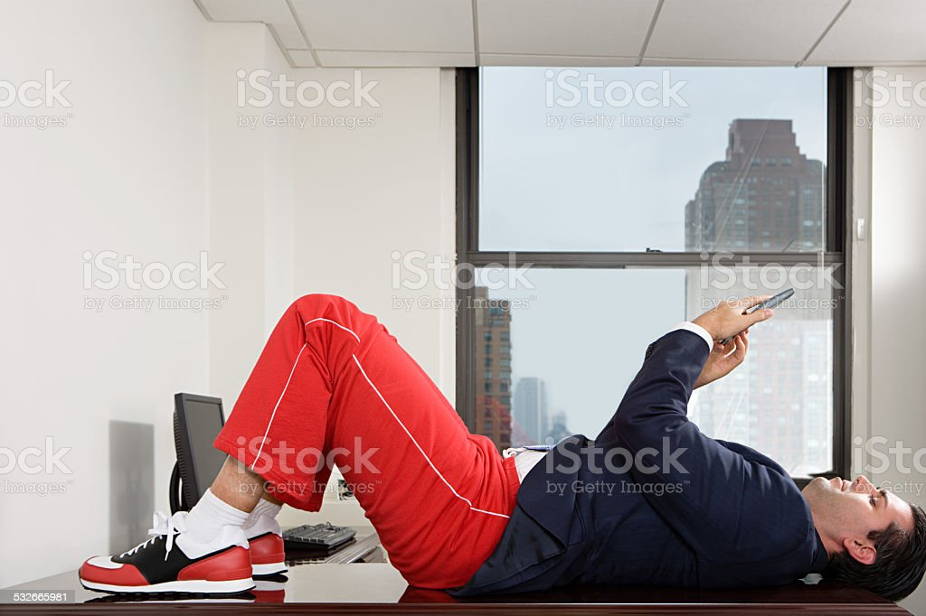 Businessman exercising in office stock photo
