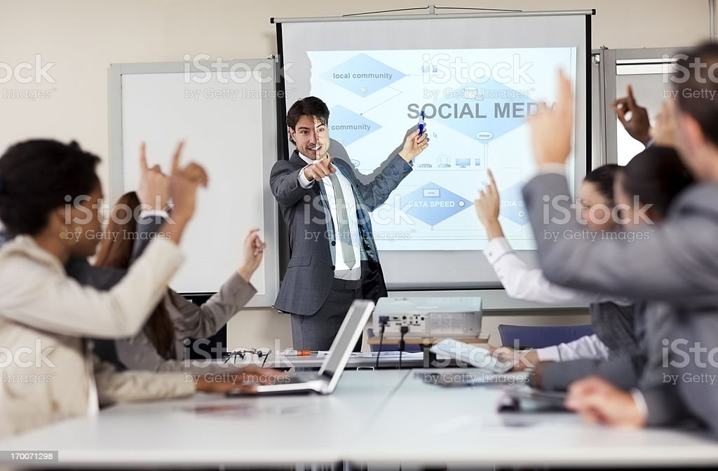 Businessman explaining in front of projection screen royalty-free stock photo