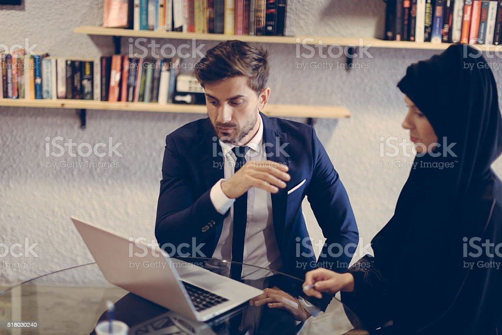 Businessman explaining project plans to colleague. stock photo