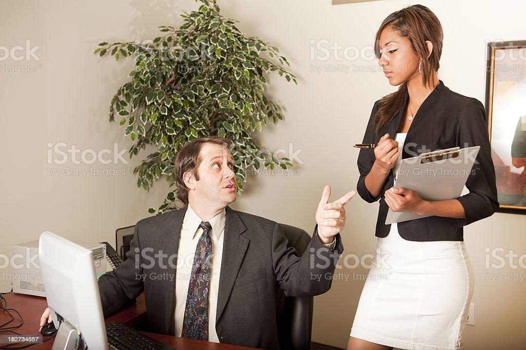 Businessman explaining to secretary royalty-free stock photo