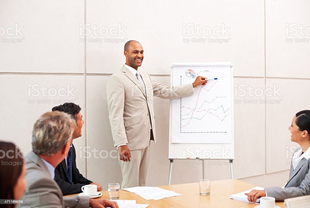 Businessman explaning to his colleague in a meeting royalty-free stock photo