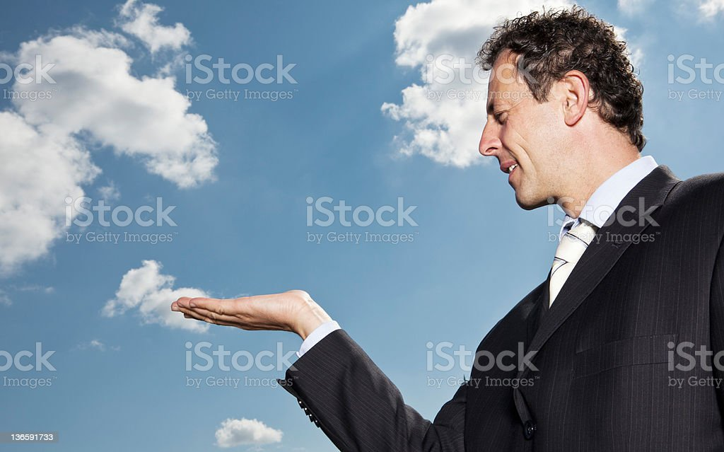 Businessman extending palm outdoors royalty-free stock photo