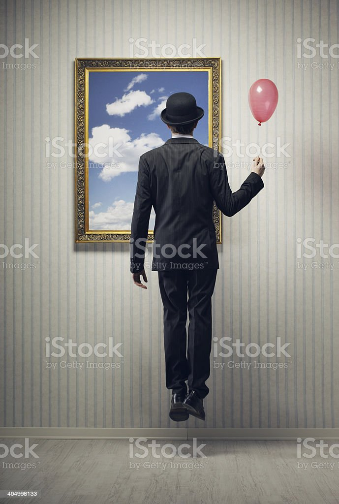 Businessman facing a painting with a red balloon stock photo