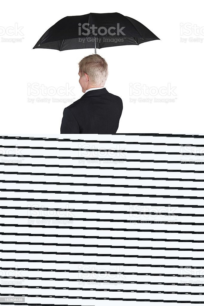 Businessman facing away with folded arms royalty-free stock photo