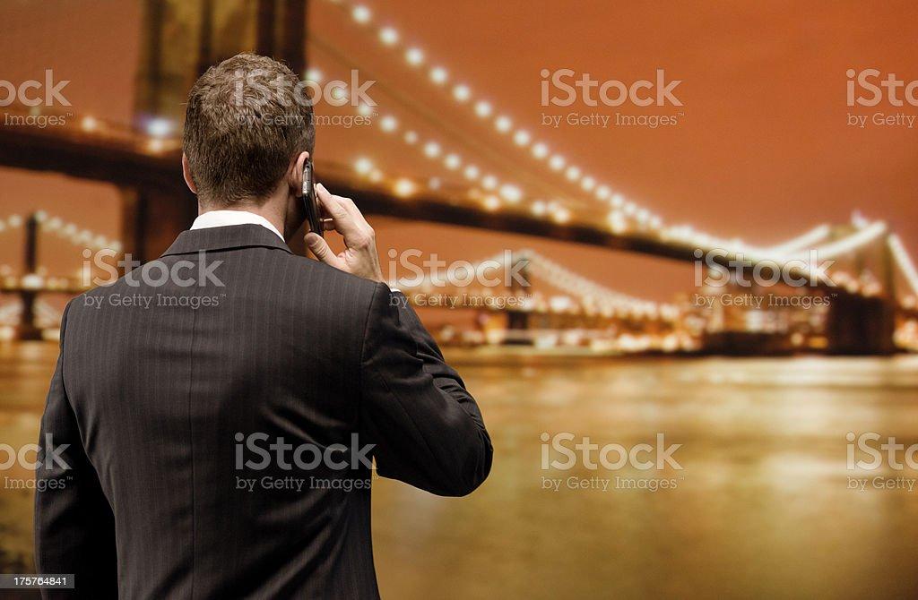Businessman facing Brooklyn Bridge royalty-free stock photo