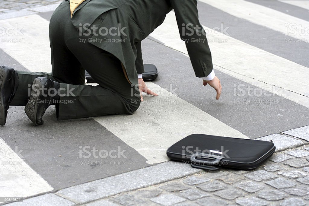 Businessman falling in the street royalty-free stock photo