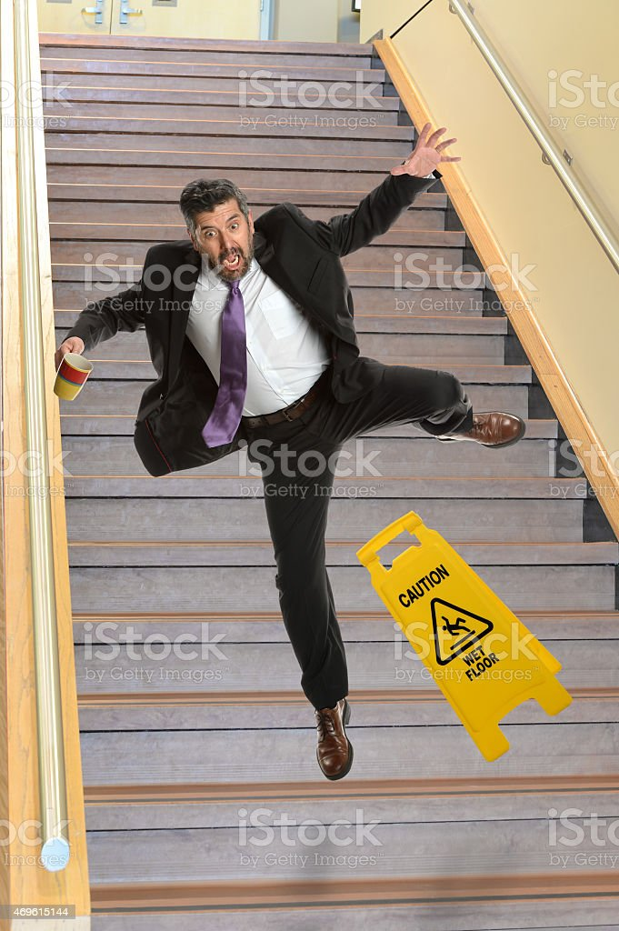 Businessman Falling on Stais stock photo