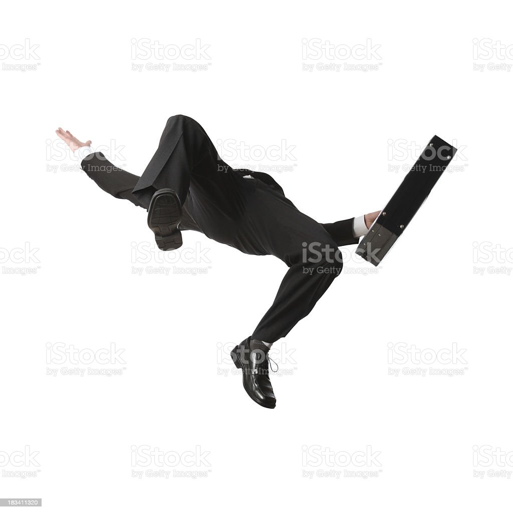 Businessman falling with briefcase royalty-free stock photo