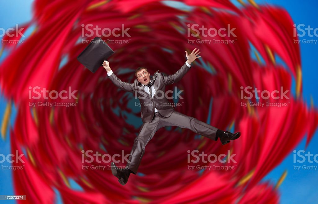 Businessman falls into abyss stock photo