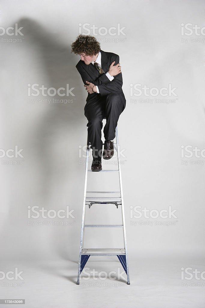 Businessman fear hights stock photo