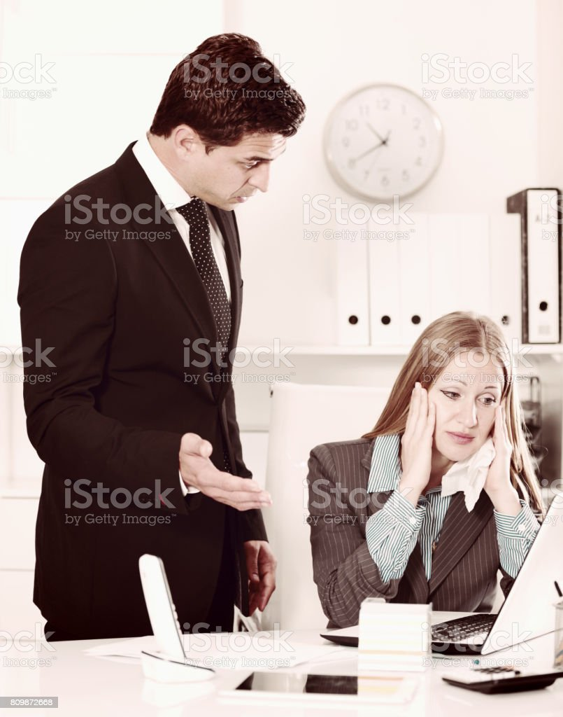 Businessman feeling angry to coworker stock photo