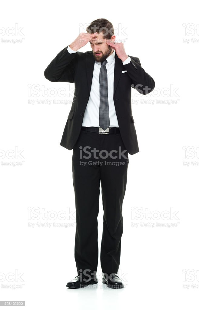 Businessman feeling headache stock photo