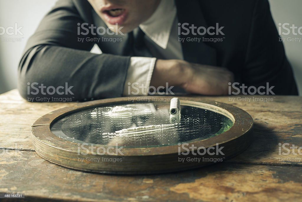 Businessman feeling ill after doing cocaine royalty-free stock photo