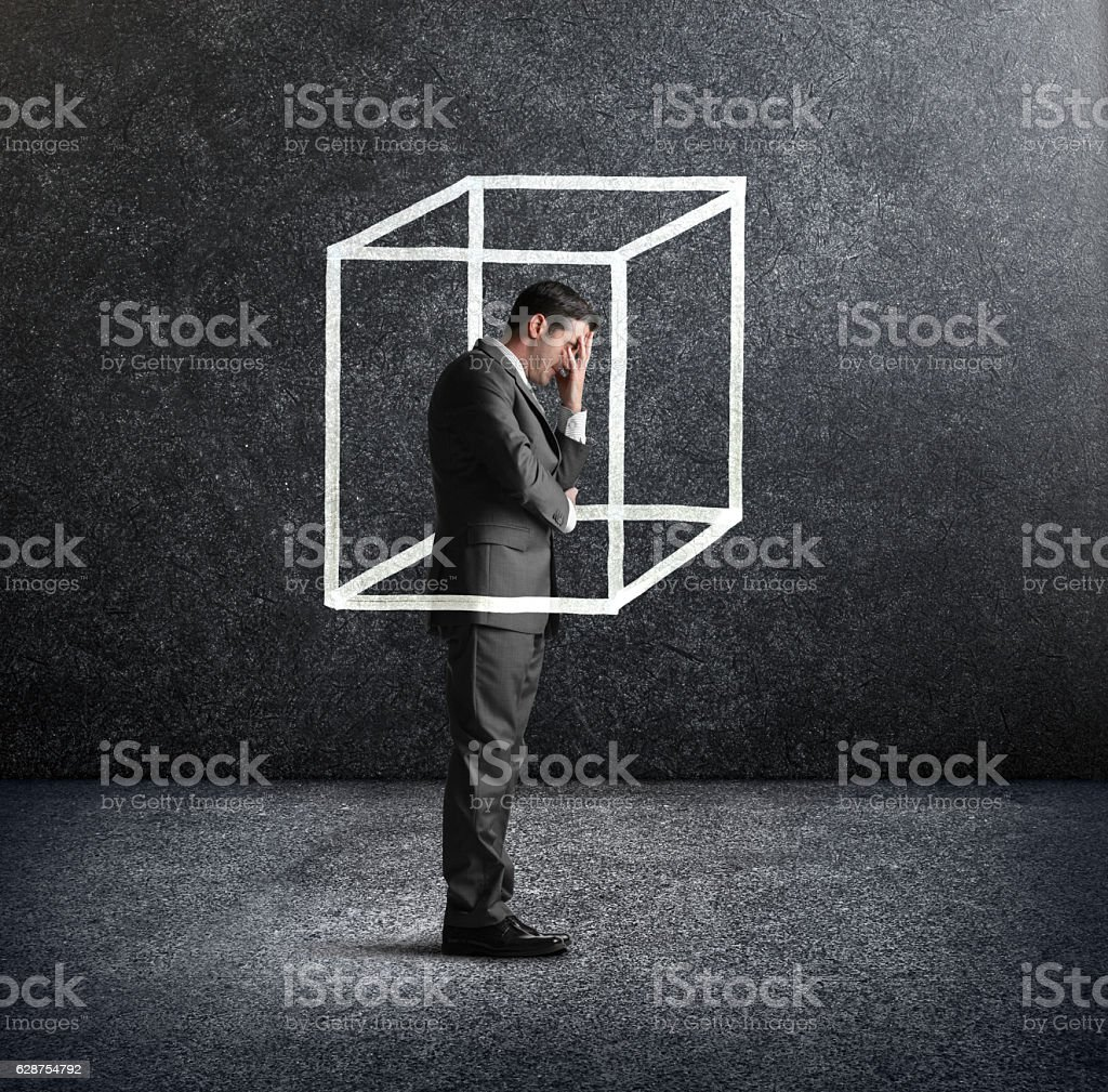 Businessman Feeling Like He Is Boxed In stock photo