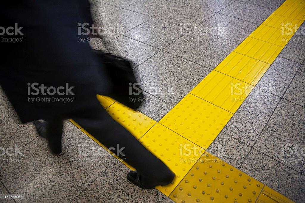 Businessman feet of walking away. stock photo