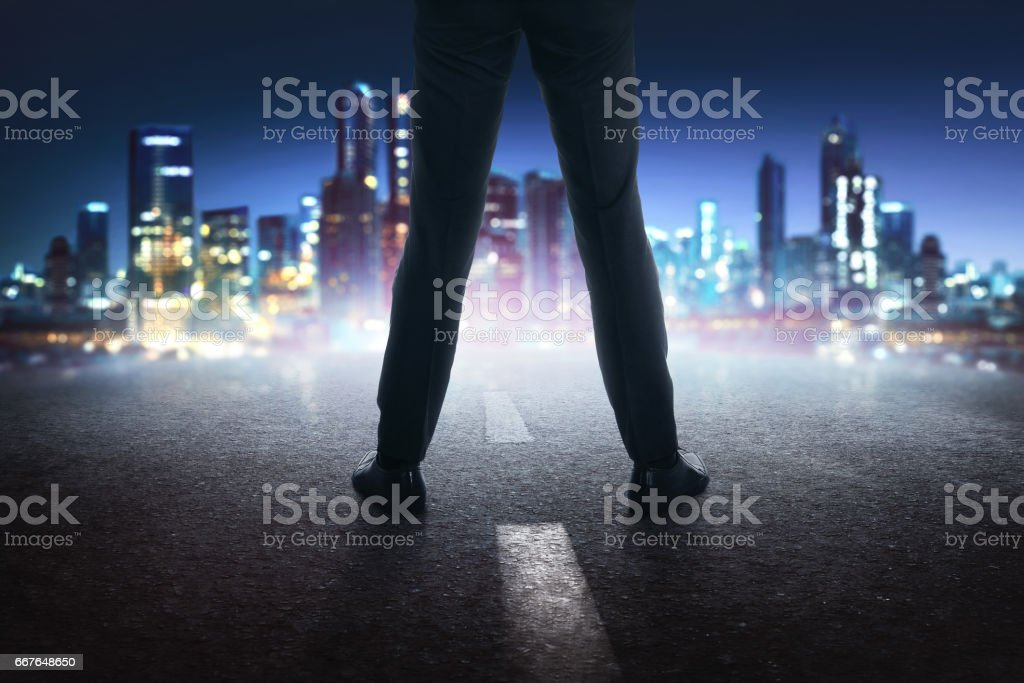 Businessman feet with black leather shoes standing on the street stock photo