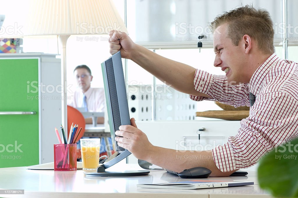 businessman fighting the computer monitor royalty-free stock photo