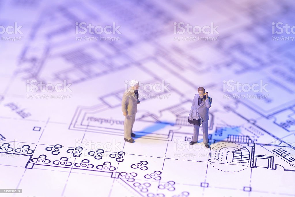 Businessman figure on the plan royalty-free stock photo