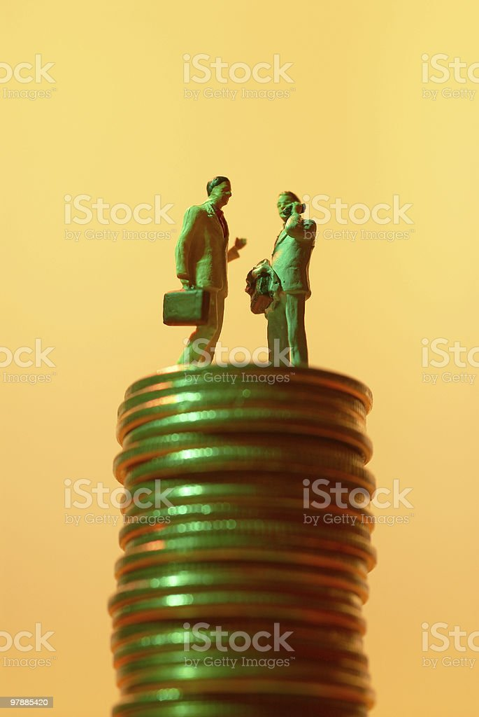 Businessman figure with coins royalty-free stock photo