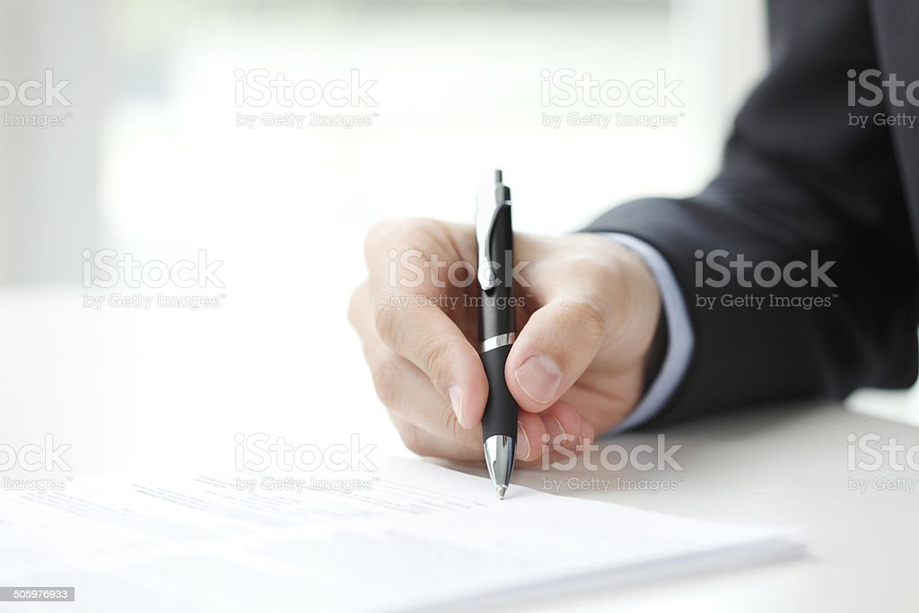 Businessman fill the form stock photo