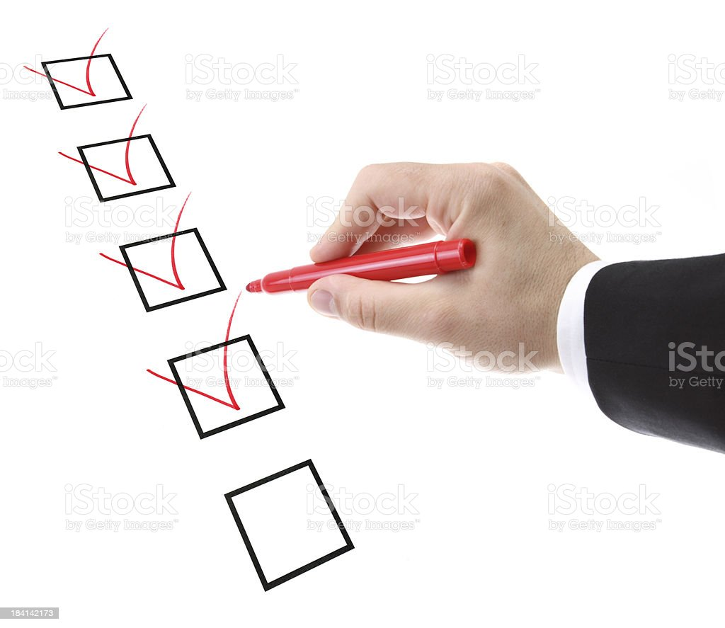 businessman filling a checklist royalty-free stock photo