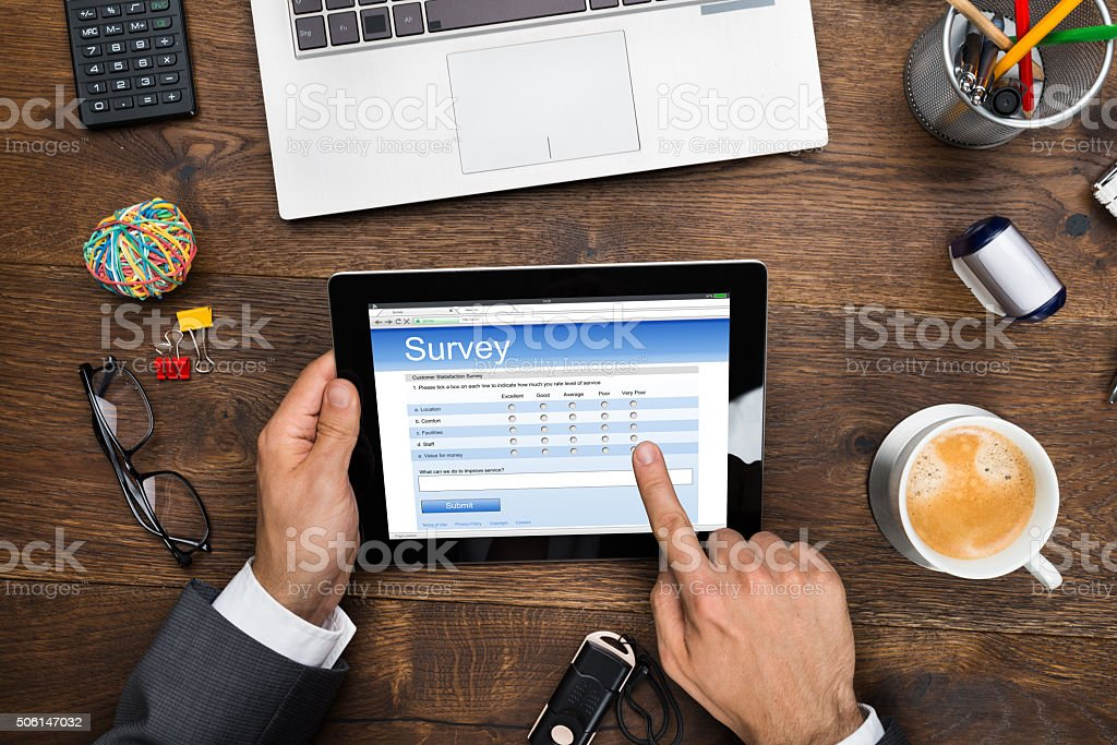 Businessman Filling Online Survey Form stock photo