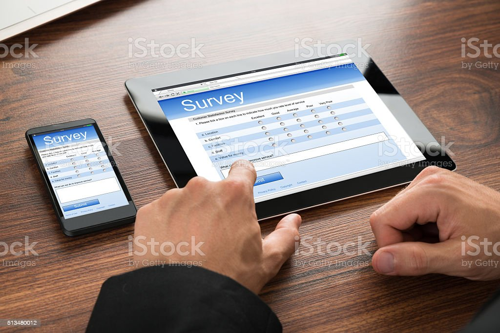 Businessman Filling Survey Form stock photo