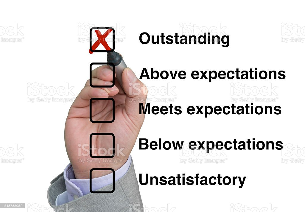 Businessman fills out performance rating stock photo