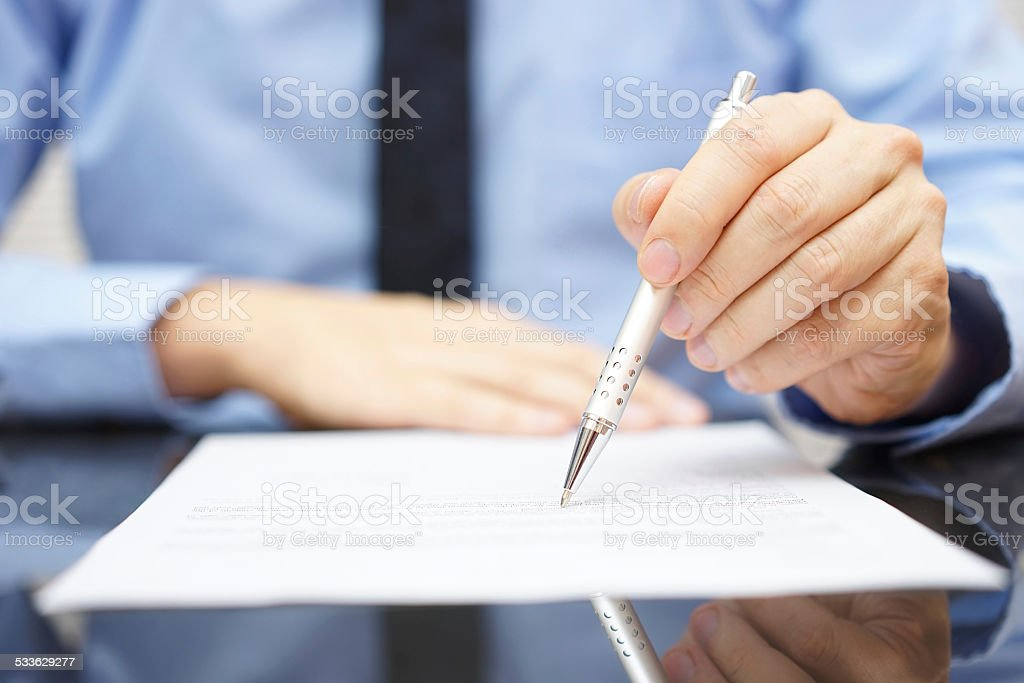 businessman find insurance scam in contract stock photo