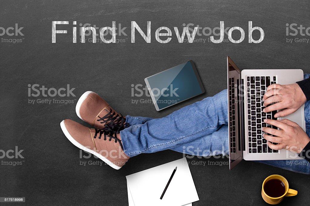 Businessman finding job on laptop stock photo
