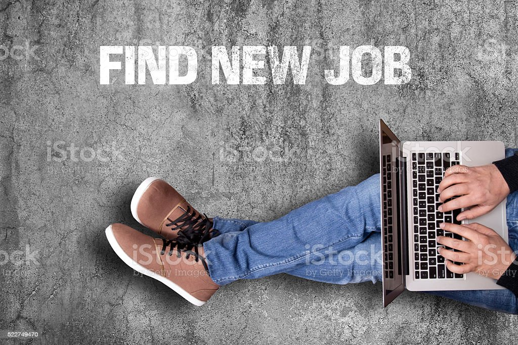 Businessman finding job on laptop stock photo
