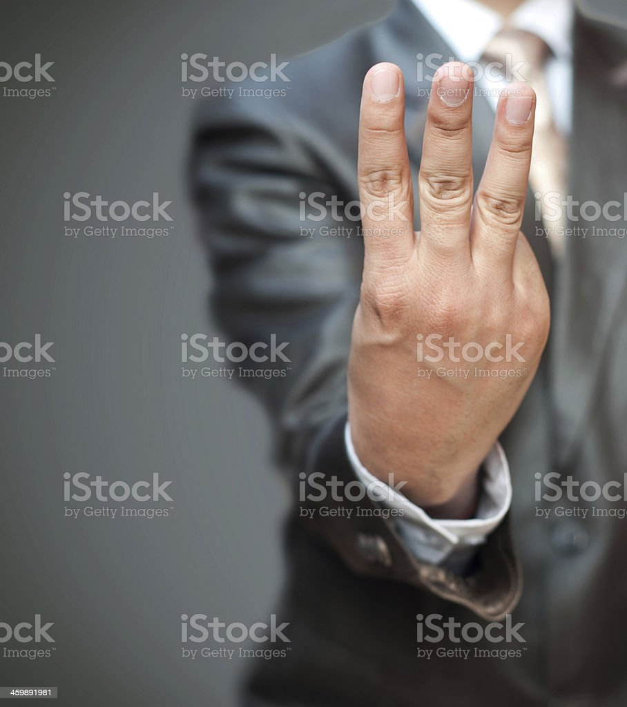 Businessman fingers up stock photo