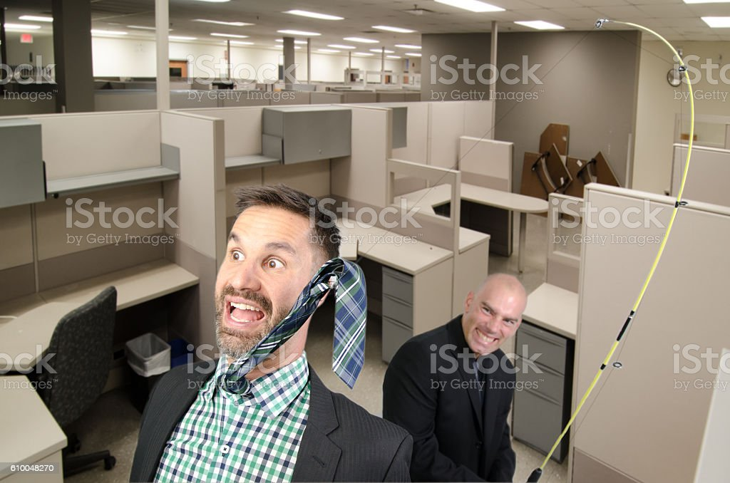Businessman fishing another one by the tie stock photo