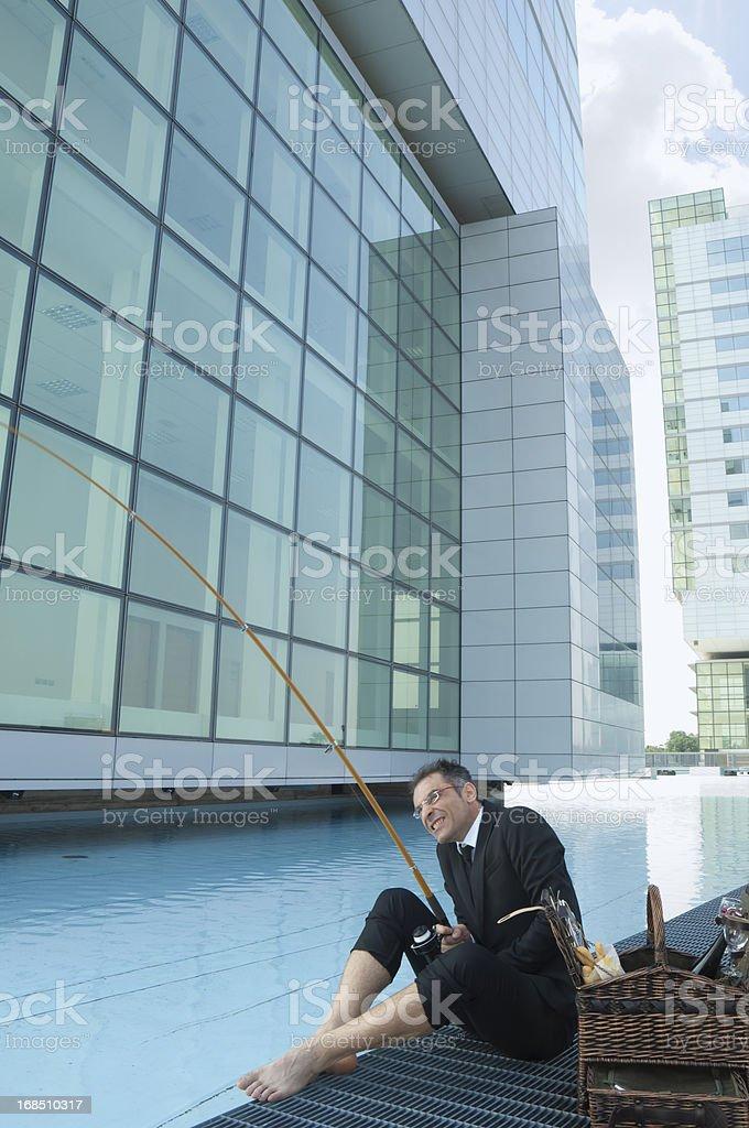 Businessman fishing in his break royalty-free stock photo