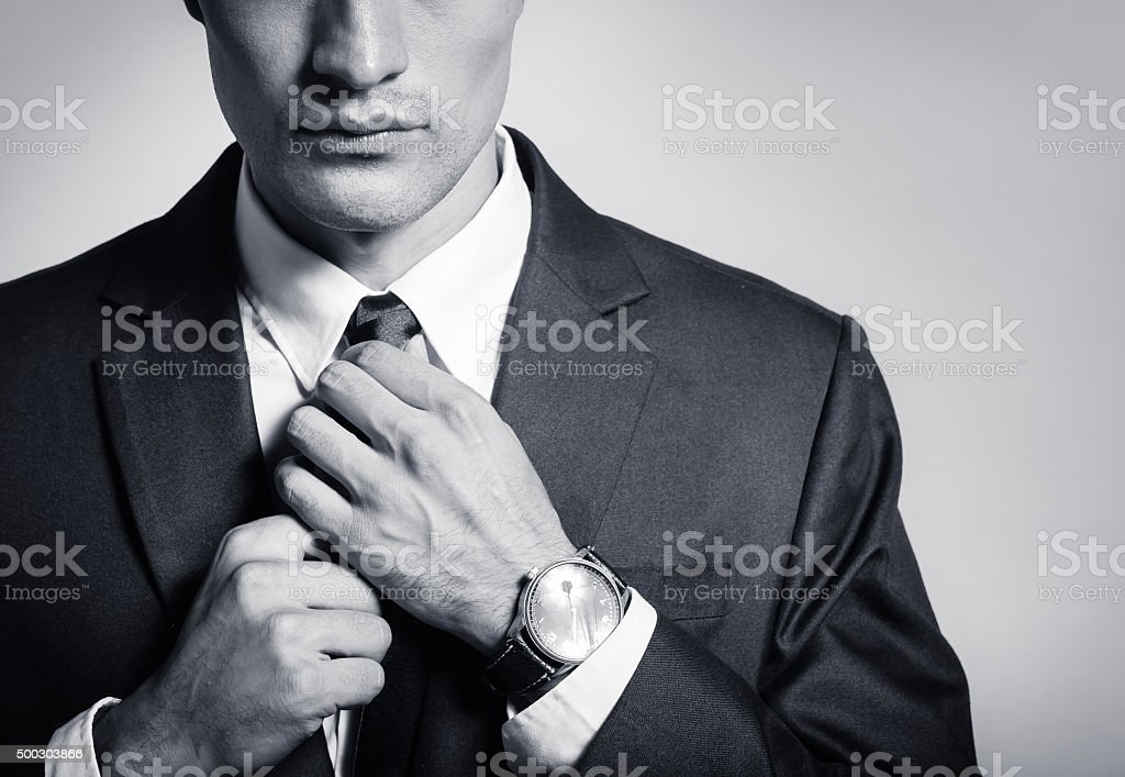 Businessman fixing his suit stock photo