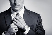 Businessman fixing his suit