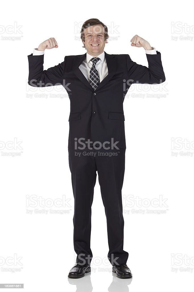 Businessman flexing biceps royalty-free stock photo