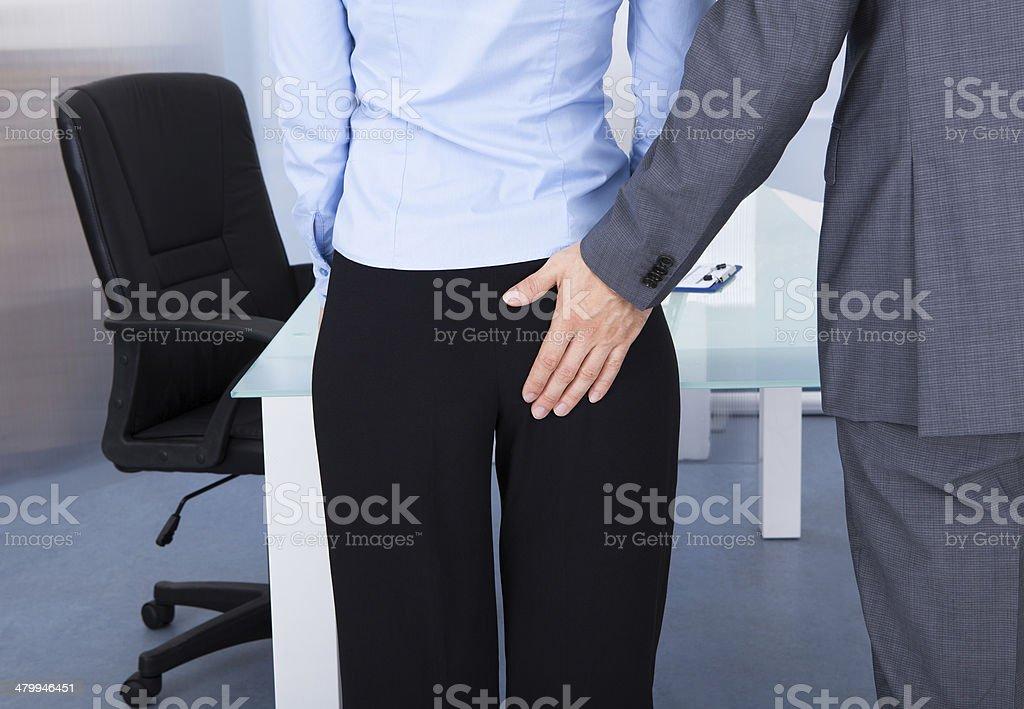 Businessman Flirting Businesswoman stock photo