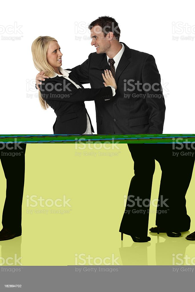 Businessman flirting with a businesswoman royalty-free stock photo
