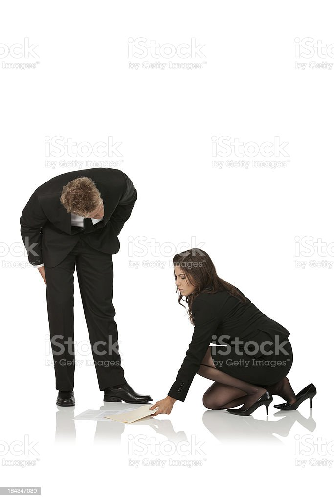 Businessman flirting with his colleague royalty-free stock photo