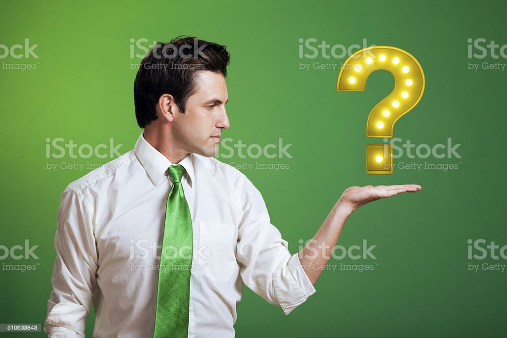 Businessman Floating a Yellow Question Mark stock photo