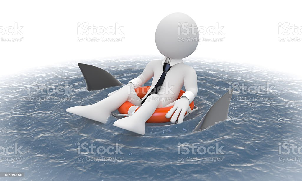 Businessman floating in a life preserver with sharks around royalty-free stock photo