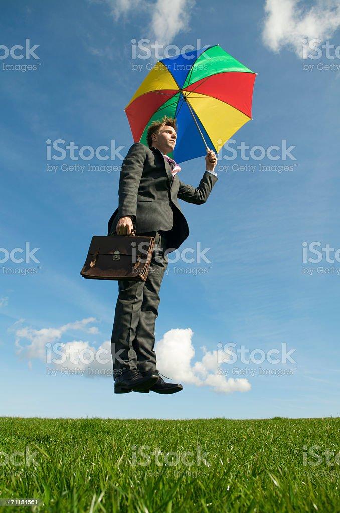 Businessman Floating w Umbrella royalty-free stock photo
