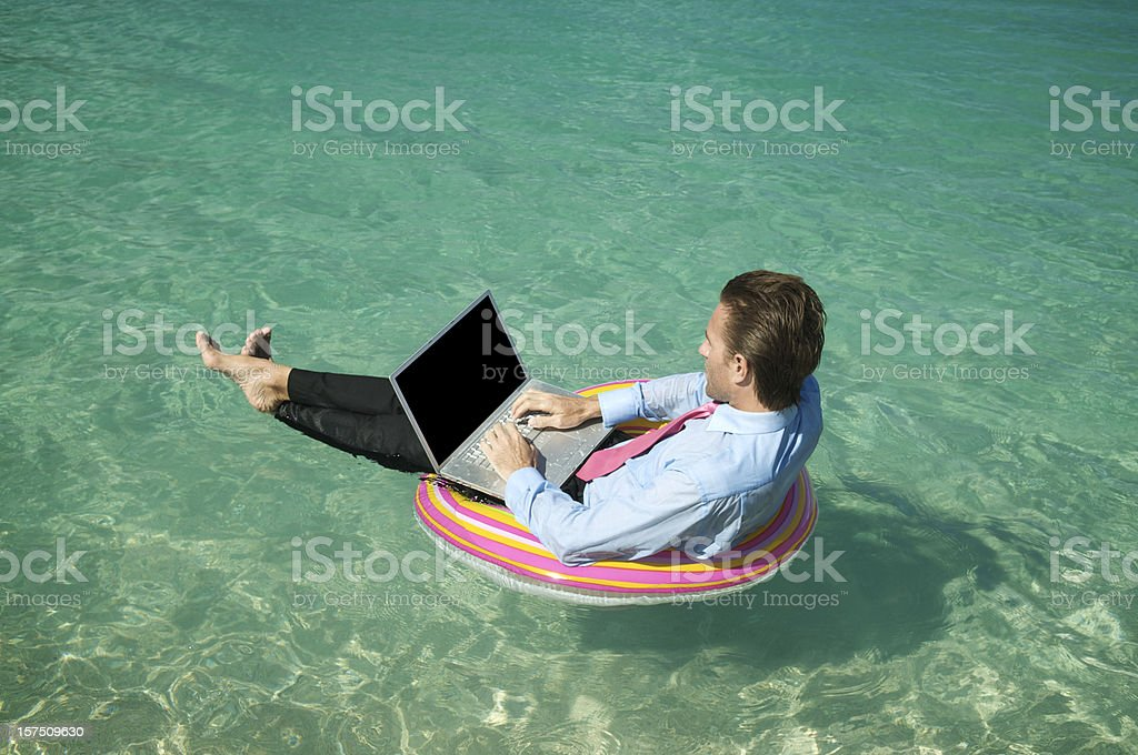 Businessman Floats and Types on Bright Ring royalty-free stock photo
