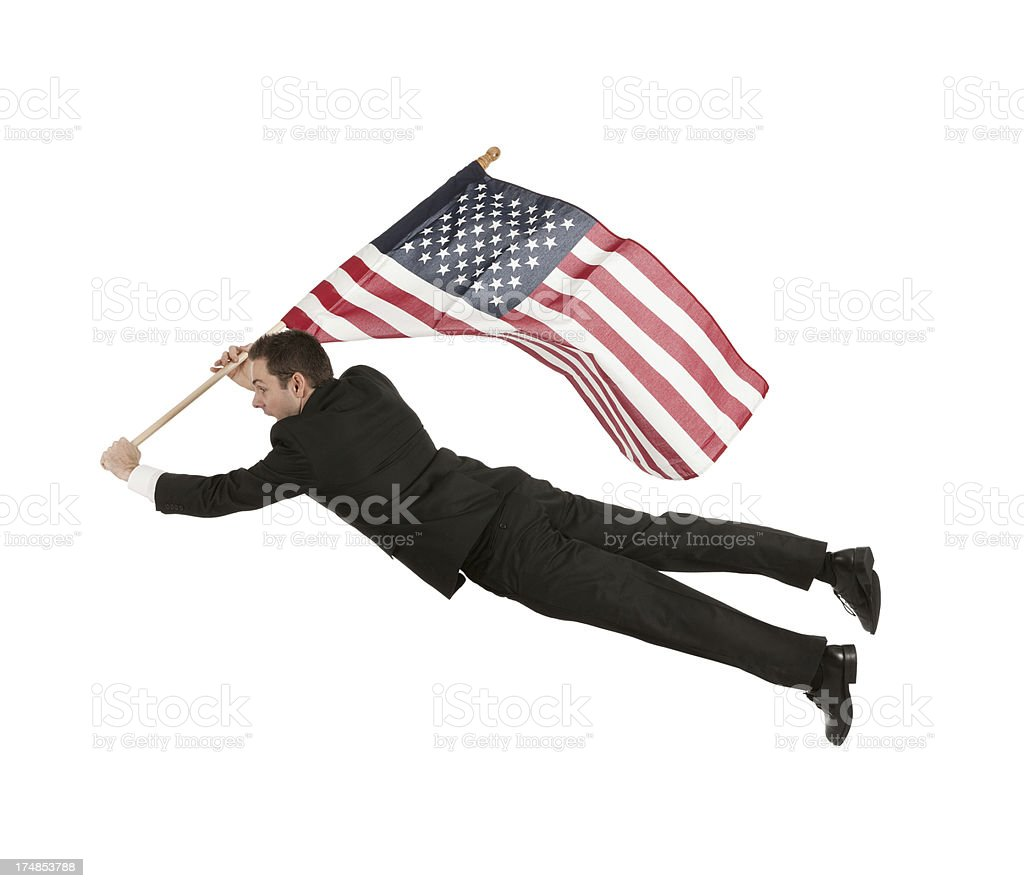 Businessman flying with an American flag royalty-free stock photo